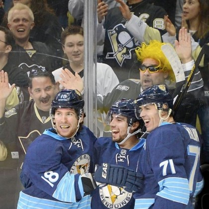 neal Matt Niskanen, center, and Evgeni Malkin congratulate James Neal, left, after making rhe score 2-0 in the third period.