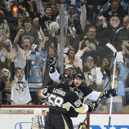 neal The Penguins' James Neal celebrates with Kris Letang after scoring a goal in the Ottawa series.