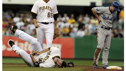 Neil Walker The Pirates' Neil Walker fell to the ground in pain after getting an injury to his right hand after a double play attempt on the Dodgers' Mark Ellis in the first inning at PNC Park Wednesday night.
