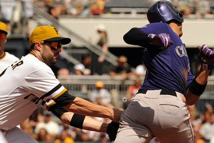 Neil Walker The Pirates' Neil Walker tags out the Rockies' Carlos Gonzalez at second base in the fourth inning.