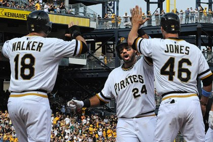 Neil Walker and Garrett Jones greet Pedro Alvarez Neil Walker and Garrett Jones greet Pedro Alvarez at home after hitting a three-run homer over the centerfield wall that gave the Pirates a 5-2 lead.