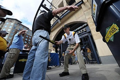 new security procedures The use of the metal-detecting wands was abandoned minutes after the Tuesday night game against the San Francisco Giants was scheduled to begin.