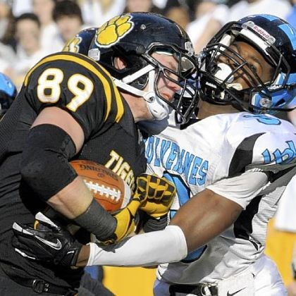 North Allegheny North Allegheny's Zach Lyon goes through Woodland Hills' Trevon Mathis to score a touchdown in WPIAL title game.