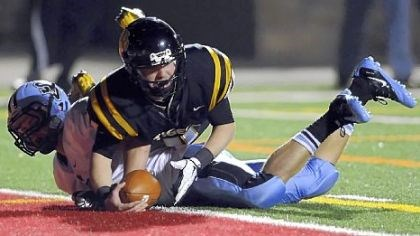 North Allegheny quarterback Mack Leftwich North Allegheny quarterback Mack Leftwich dives into the end zone Friday night for a touchdown against Seneca Valley's Benjamin Hodges.