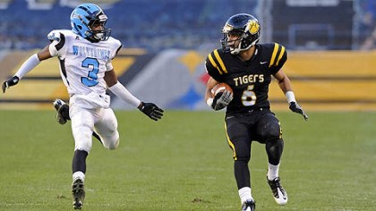 North Allegheny's Elijah Zeise carries football North Allegheny's Elijah Zeise carries as as he's defended by Woodland Hills' Trevon Mathis Friday in the WPIAL class AAAA championships at Heinz Field.