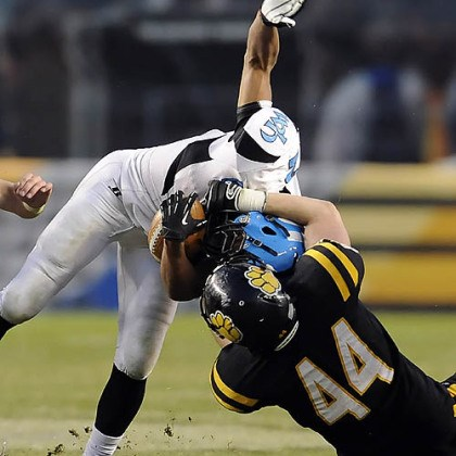 North Allegheny's Kevin Edwards North Allegheny's Kevin Edwards takes down Woodland Hills' Dequan White Friday in the WPIAL class AAAA championships at Heinz Field.
