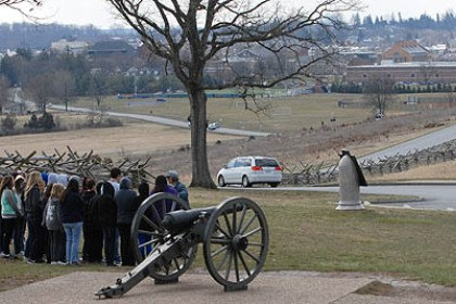 Oak Ridge A tour group of visitors gathers at Oak Ridge, the site of the Eternal Light Peace memorial, where Confererate Major Robert Rhodes' Division stepped off to attack Union forces at McPhearson Ridge and Seminary Ridge. The town of Gettysburg is in the background.
