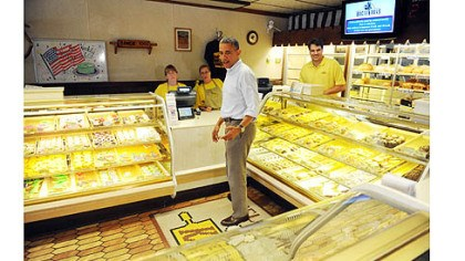 obama at kretchmar 2 President Obama looks over his options at Kretchmar's Bakery.