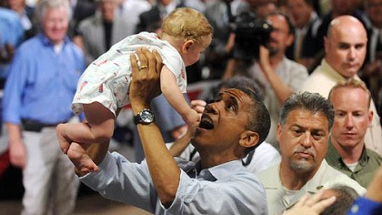 Obama holding baby Ohio President Barack Obama lifts 9-month-old Nathan Maxwell Johnson of Youngstown into the air after speaking at a campaign event at Dobbins Elementary School in Poland, Ohio this morning.