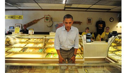 obama inside kretchmar's The president examines the bakery cases at Kretchmar's