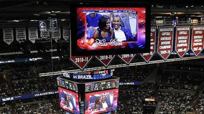 Obamas on the Kiss Cam President Barack Obama and first lady Michelle Obama are seen on the in-house television monitors during the 'Kiss Cam' segment as they attend the U.S. men's Olympic basketball exhibition game between Team USA and Brazil in Washington, Monday, July 16, 2012.
