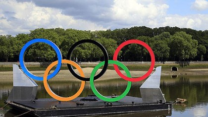 On the River Thames John Biggins, of Australia, take pictures of the Olympic rings floating on the River Thames.