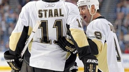 Pascal Dupuis and Jordan Staal Pascal Dupuis, right, celebrates his third-period goal with Jordan Staal.