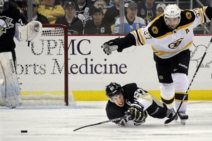 PatriceBergeron Boston's Patrice Bergeron trips Sidney Crosby going for the puck in the third period Tuesday.