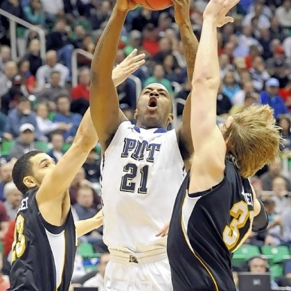 Patterson Pitt's Lamar Patterson draws contact from Wichita State players Thursday in Salt Lake City.