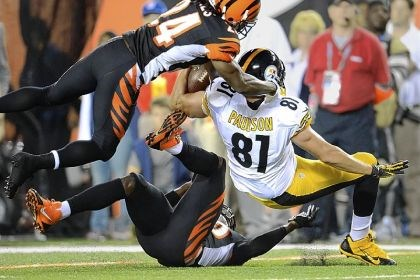Paulson fumbles Cincinnati's Adam Jones knocks the ball from Steelers tight end David Paulson deep in Cincinnati territory in the first half Monday night.