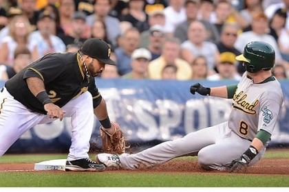 Pedro Alvarez Athletics infielder Jed Lowrie slides under the tag of Pirates third baseman Pedro Alvarez at PNC Park.