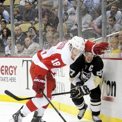 pens2 Sidney Crosby fights with Joakim Andersson for the puck Monday night against the Detroit Red Wings in the Penguins' first exhibition home game at Consol Energy Center.