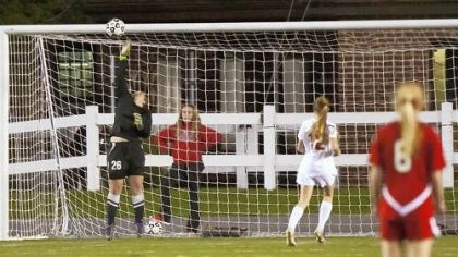 Peters Soccer Emily Franty's game-winning goal sails over the outstretched hand of Cumberland Valley goalkeeper Dani Shambaugh.