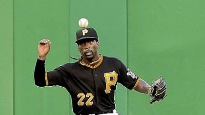 Pirates Pirates center fielder Andrew McCutchen runs down hit by the Giants' Melky Cabrera Friday night at PNC Park.