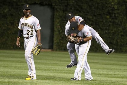 pirates Andrew McCutchen, Starling Marte and Marlon Byrd celebrate the Pirates' 2-1 win over the Chicago Cubs and clinching a playoff berth.
