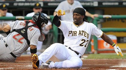 Pirates Andrew McCutchen slides safely past Astros catcher Carlos Corporan in the first inning Wednesday night at PNC Park.