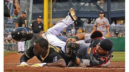 Pirates Josh Harrison was out at the plate, but St. Louis Cardinals catcher Yadier Molina was knocked from the game on this collision in the bottom of the second inning Tuesday night at PNC Park.