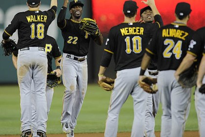 Pirates' Andrew McCutchen 5 Andrew McCutchen, Neil Walker and teammates celebrate the win over the Washington Nationals.