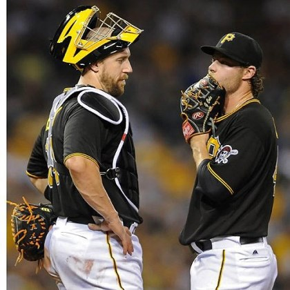 Pirates catcher John Buck Pirates catcher John Buck talks with Gerrit Cole after walking Brewers' Caleb Gindl in the fourth inning Thursday night at PNC Park.