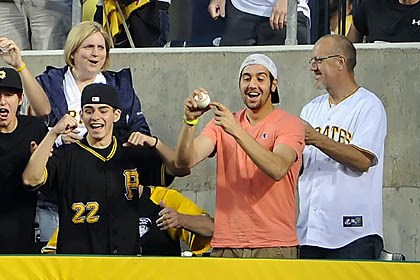 Pirates fans A Pirates fan celebrates after grabbing a home run ball hit by Jose Tabata in the fourth inning.