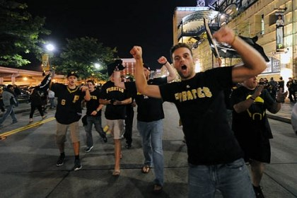 Pirates fans Fans celebrate outside PNC Park after the Pirates defeated the Reds, 6-2.