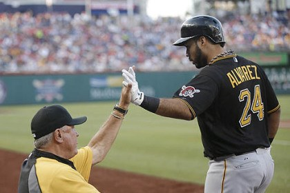 Pirates' Pedro Alvarez Pedro Alvarez is greeted in the dugout by manager Clint Hurdle after hitting a solo home run in the second inning off Washington starting pitcher Stephen Strasburg.