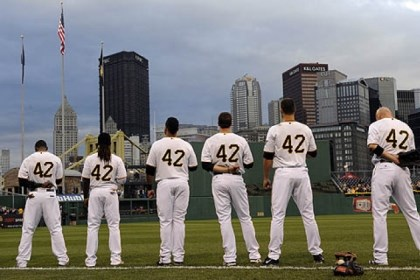 Pirates players Pirates players stand as the National Anthem is played Monday at PNC Park. All players wore the number 42 in honor of Jackie Robinson day.