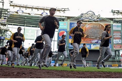 Pirates players Pirates players run before taking batting practice as they prepare to take on the Brewers at Miller Park Wednesday night.