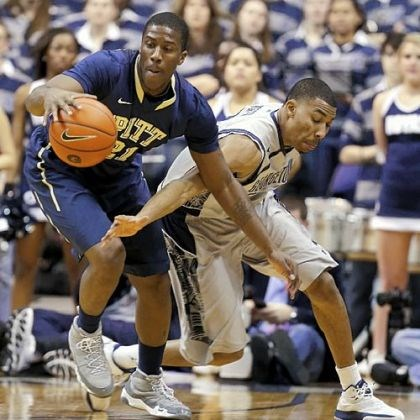 Pitt BB Lamar Patterson keeps the ball away from Georgetown's Otto Porter Jr. on Tuesday night in Pitt's win. The Panthers hope their more physical style of play bodes well for the rest of the season.