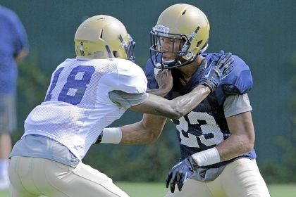 pittfb2 Pitt cornerback Titus Howard, left, and Tyler Boyd, freshmen from Clairton, work out in practice Thursday on the South Side. Boyd likely locked up a starting job at wide receiver, and Howard has made a good enough impression on coaches to possibly see playing time.