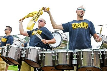 Pittsburgh Steeline band Members of the Pittsburgh Steeline band Mark Surovchak, left, 34 and Dustin Lowes, 32, wave Terrible Towels while playing their drums Saturday at Steelers training camp.