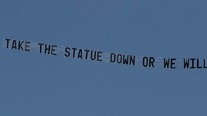 "plane banner psu A plane flying over the Penn State University campus in State College, pulls a banner reading ""Take the statue down or we will"" today."
