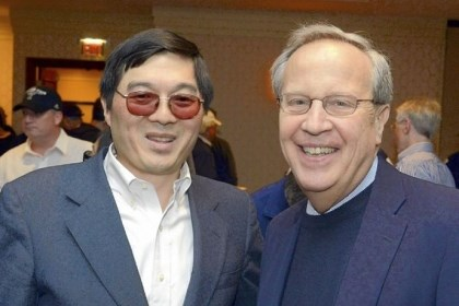 President Otto Chu, left, CEO of Chu Financial Management, and Richard Levin, president of Yale University, talk at a Frozen Four gathering at Marriott Pittsburgh City Center, Downtown, Saturday. Mr. Chu is also first vice president of the Yale Club of Pittsburgh.