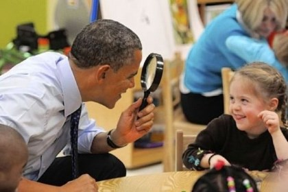 President Barack Obama President Barack Obama uses a magnifying glass to play with a young girl Thursday during a visit to College Heights Early Childhood Learning Center in Decatur, Ga. The president is proposing a nationwide initiative for children in pre-kindergarten.