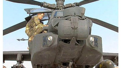 Prince Harry Prince Harry is shown in an Apache helicopter Friday in an image taken from video by a member of his squadron at Camp Bastion in Afghanistan.