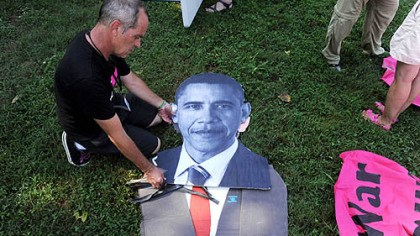 Protest in Charlotte Tighe Barry of Los Angeles creates a cutout of President Barack Obama for the March on Wall Street South protest before the start of the Democratic National Convention in Charlotte, N.C., on Sunday.