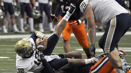 Quarterback Tino Sunseri is sacked Quarterback Tino Sunseri is sacked by Syracuse's Brandon Sharpe during the first quarter Friday night in Syracuse, N.Y.