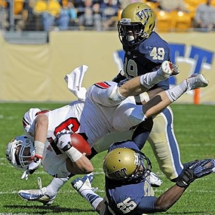 radcliff Louisville's Scott Radcliff is upended by Pitt's Jason Hendricks Saturday at Heinz Field. No. 18 Louisville spoiled Pitt's homecoming, riding a big second half to a 45-35 victory.