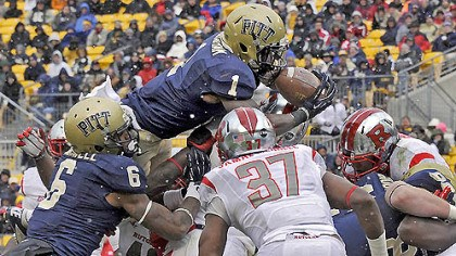 Ray Graham Pitt's Ray Graham dives into the end zone for a touchdown against Rutgers in the second quarter.