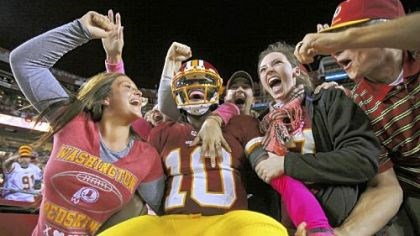 rg3 Robert Griffin III celebrates with happy Redskins fans at FedEx Field after a 76-yard touchdown run against Minnesota Oct. 14 == the longest scoring run by an NFL quarterback since Kordell Stewart went 80 yards in 1996.