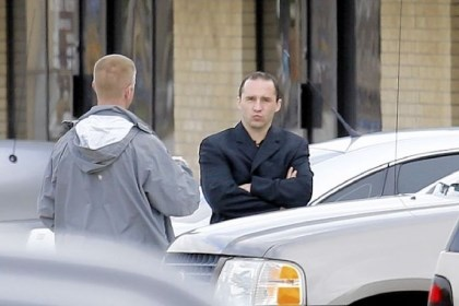 Ricin Everett Dutschke, right, confers Wednesday with a federal agent near the site of a martial arts studio he once operated in Tupelo, Miss. The property was being searched in connection with the investigation of ricin-laced letters that were mailed to President Barack Obama and others.