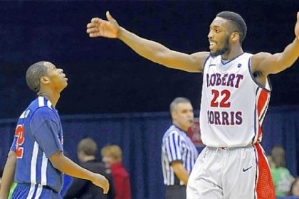 rmu1 Robert Morris'' Lucky Jones celebrates near the end of his team''s win against St. Francis Wednesday night.