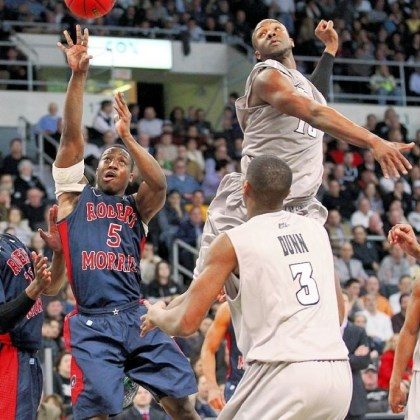 RMU2 Robert Morris guard Anthony Myers-Pate shoots against Providence forward Kadeem Batts in the second half.