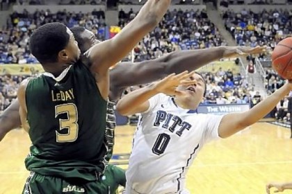 robinson Pitt's James Robinson drives to the net against South Florida's Zach Leday in the first half Wednesday at Petersen Events Center. Coach Jamie Dixon likely will not use the freelance offense his team used against the Bulls much more.